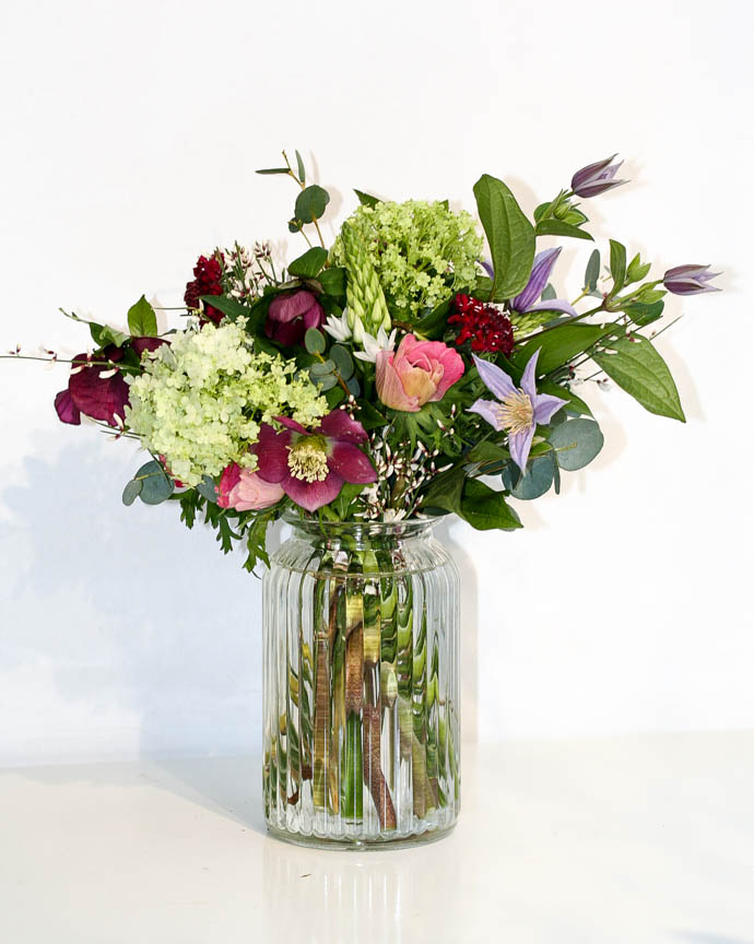 Medium size Fab Friday Flowers, mix of hellebore, viburnum and clematis