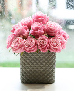 Square textured cement planter with pink rose dome, created by north London florist Garland