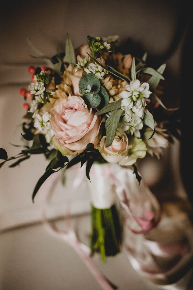 Brides bouquet in blush and gold, created by Garland, north London florist