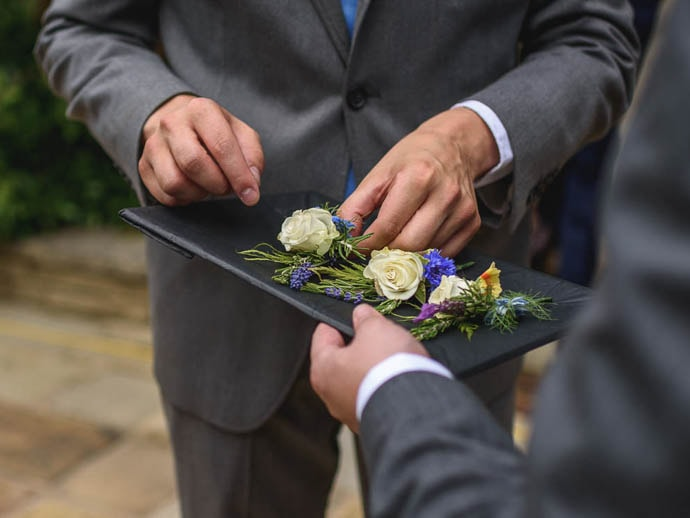 Wedding boutonniere, rose and cornflowers, created by Garland