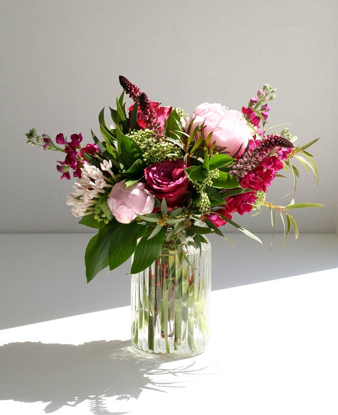 Cerise Stocks and beautiful pink peonies, arranged by Garland, north London Florist