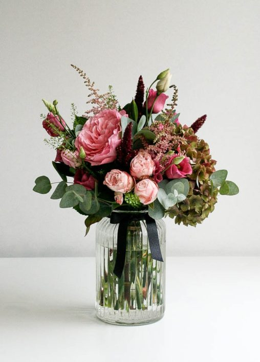 Bouquet delivered in vase with pink roses and English hydrangea