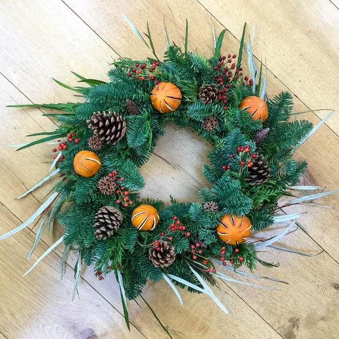 Christmas wreath with berries and oranges