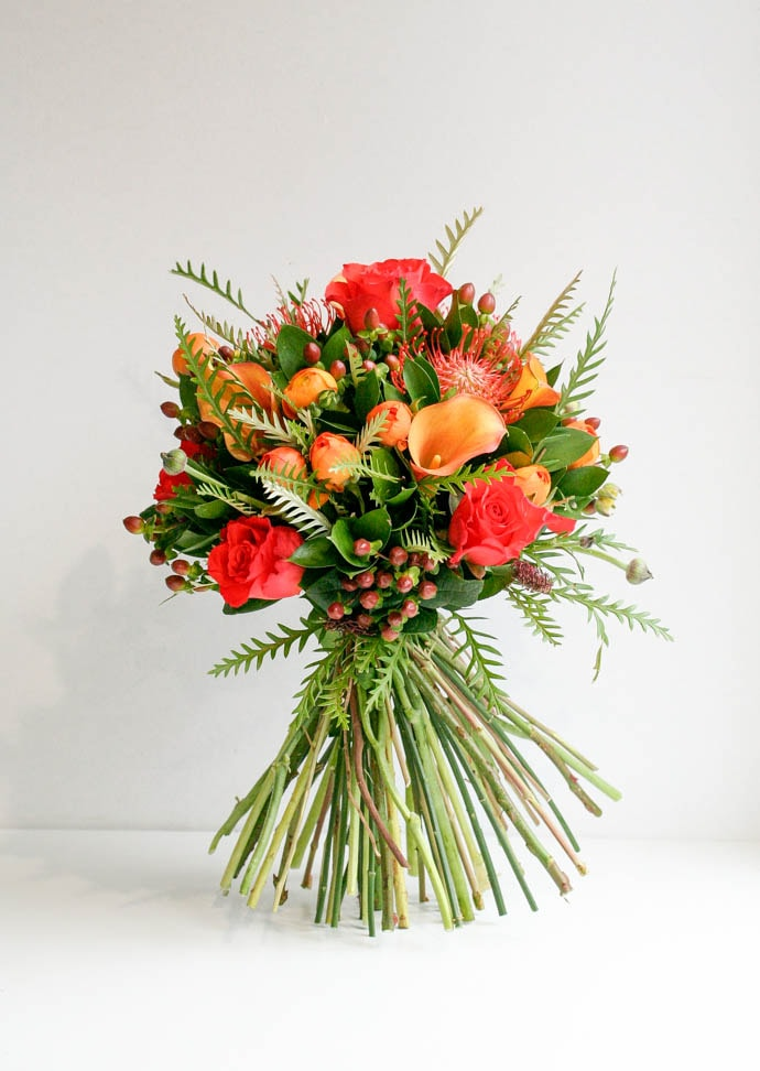Mother's Day Flowers, gorgeous orange rose and calla lily bouquet, created by Garland North London florist